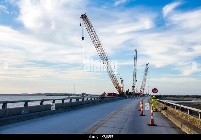 North Carolina NC Outer Banks Cape Hatteras National Seashore Rodanthe Herbert C. Bonner Bridge construction crane - Stock Image