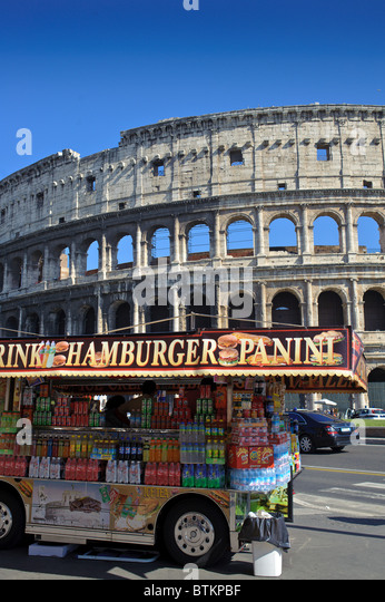 Rome ruin Colosseum with drink and hamburger panini street vending truck outside - Stock Image