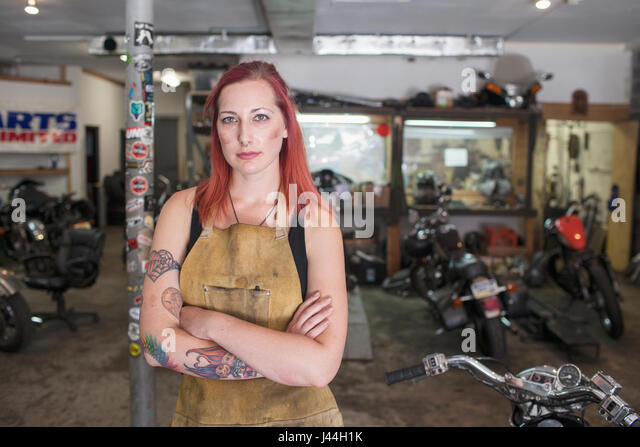 A portrai of a young woman in a dirty apron. - Stock Image