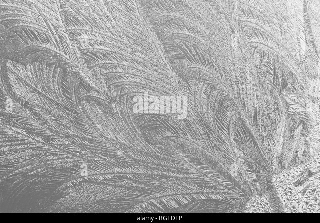 snowflake pattern frozen freeze frost icy glass - Stock Image