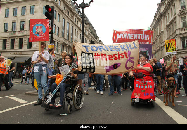London, UK - 1 July 2017 - Two wheelchair-bound demonstrators take part in a national demonstration demanding for - Stock Image