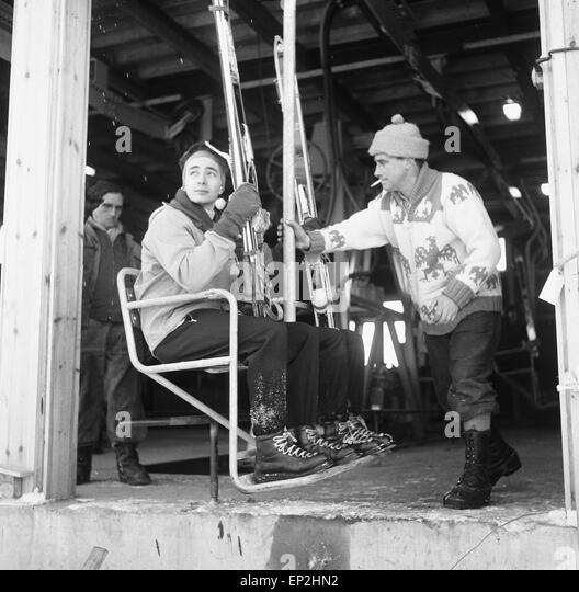 Two skiers seen here boarding the recently opened White Lady chair lift on Cairngorm 3rd January 1962 - Stock Image