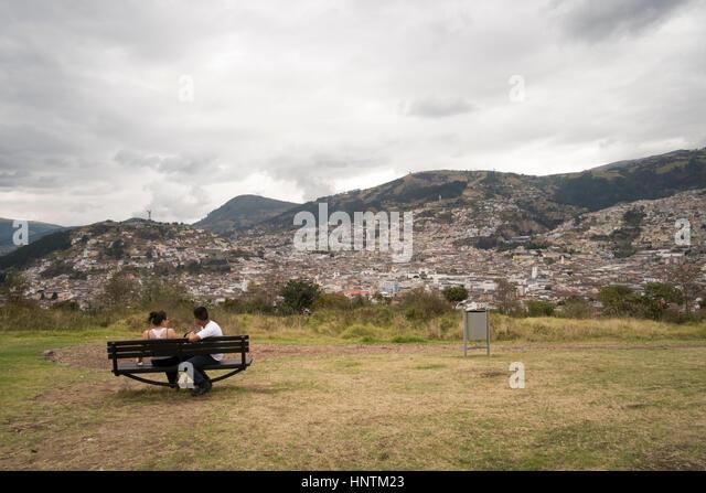 A couple on a bench in Parque Itchimbia Quito , Ecuador - Stock Image