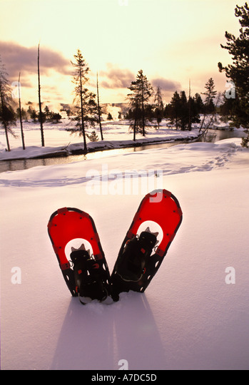 Snowshoes in the snow along the Firehole River in Yellowstone National Park Wyoming - Stock-Bilder