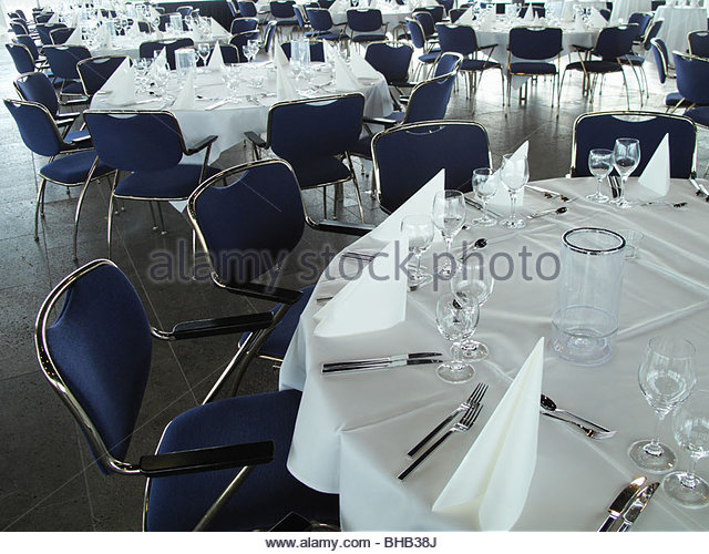 Place settings on round banquet tables - Stock Image