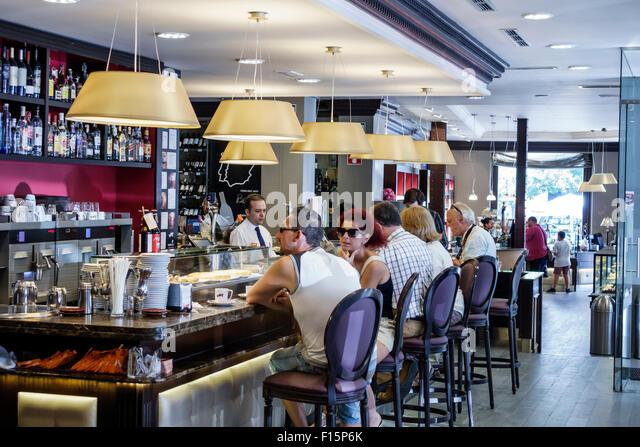 Spain Europe Spanish Madrid Retiro VAIT restaurant inside interior bakery gourmet shop dining Hispanic customers - Stock Image