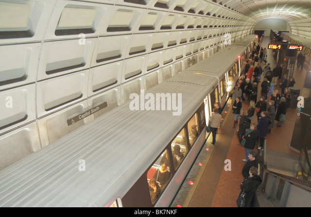 Washington DC Capitol South Metro Station rapid transit system public transportation train stopped boarding man - Stock Image
