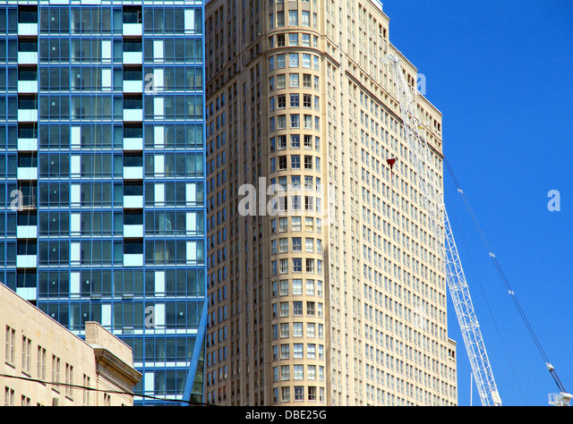 Contrasting architecture against a blue sky in Toronto, Canada - Stock Image