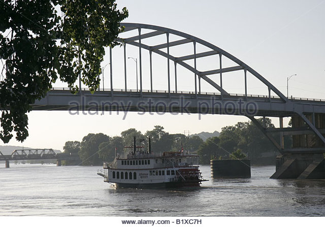 Arkansas Little Rock Arkansas River Arkansas Queen riverboat navigate passengers steamboat paddlewheel bridge excursion - Stock Image