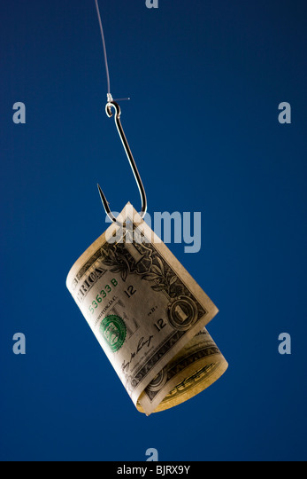 One US dollar bill on hook, against blue background - Stock Image