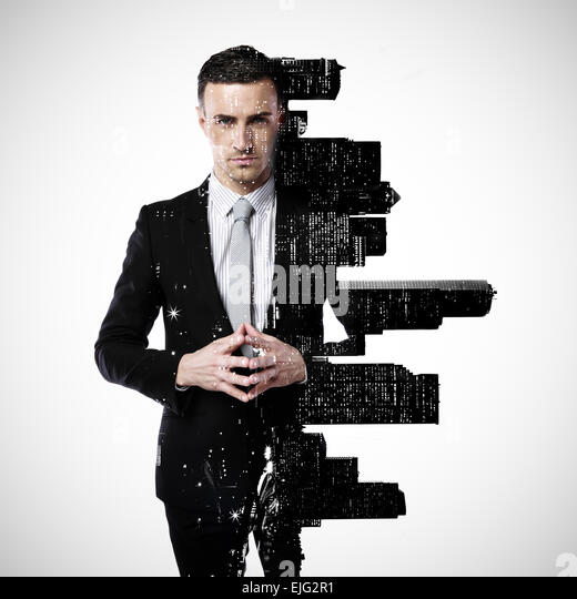 Double exposure of a city and professional businessman standing on a gray background - Stock Image