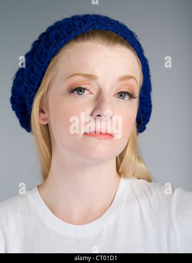 Beautiful girl shows a mean girl look of contempt - Stock Image