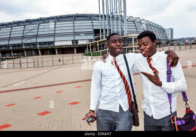Johannesburg South Africa African Soweto Lafarge Orlando Stadium Black teen boy friends student talking - Stock Image