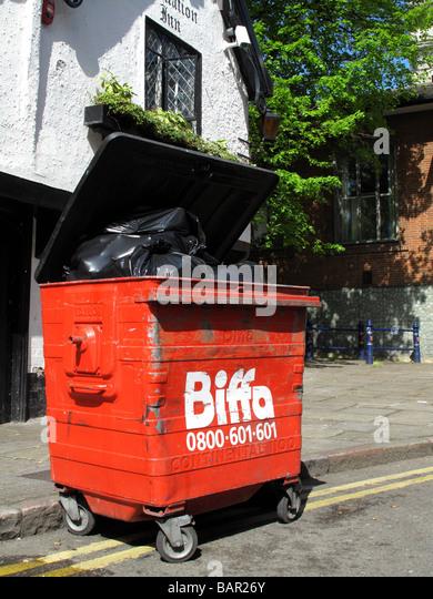 A Biffa Waste skip on a U.K. street. - Stock Image