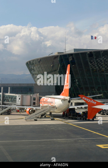 Airplane of EasyJet Airline at terminal building Nice Cote d'Azur Airport France - Stock Image