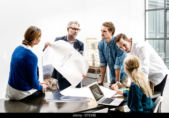 Business people in meeting at office - Stock Image