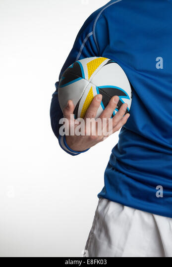 Close up of man holding Rugby ball - Stock Image