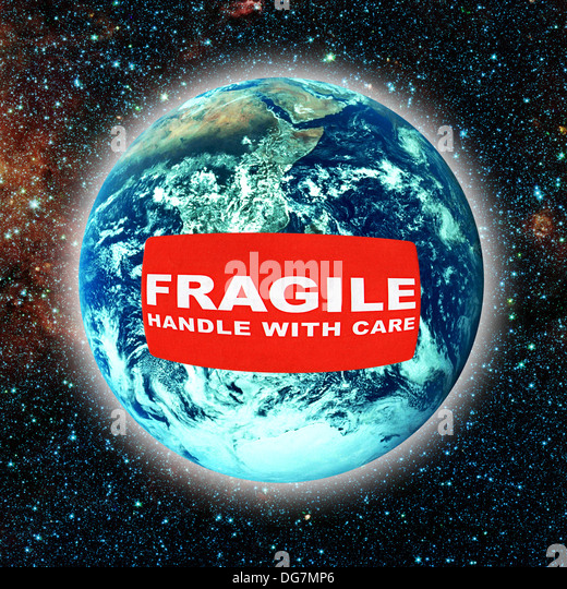 planet earth with a fragile label stick on it - Stock Image