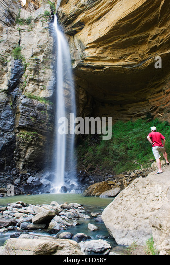 Tourist at El Hayal Waterfall, Santa Sofia, near Villa de Leyva, Colombia, South America - Stock Image