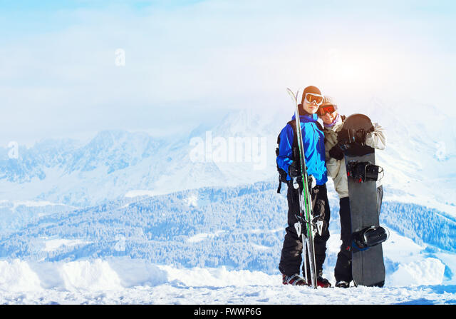 winter sports, happy young family at ski holidays - Stock-Bilder