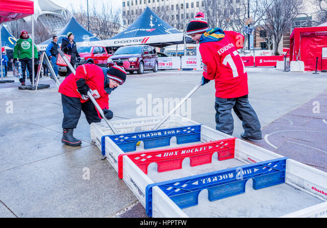 Boys playing Box Hockey, Rogers Hometown Hockey Event, Winston Churchill Square, Edmonton, Alberta, Canada - Stock Image
