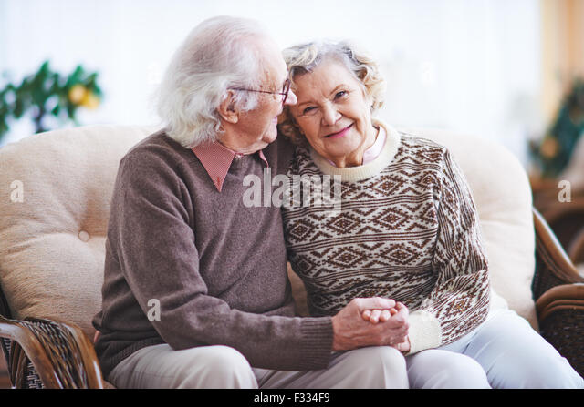 Happy senior man and woman having rest at home - Stock Image