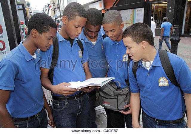 Santo Domingo Dominican Republic Ciudad Colonial Calle el Conde Peatonal Black Hispanic student boys group teen - Stock Image