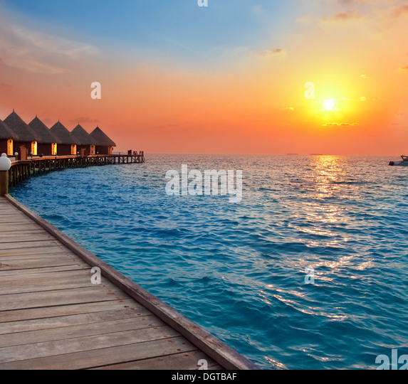 Island in ocean, Maldives.  Sunset - Stock Image
