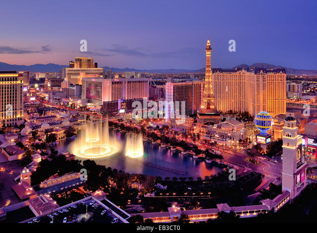 City skyline at night with Bellagio Hotel water fountains, Las Vegas, Nevada, America, USA - Stock Image