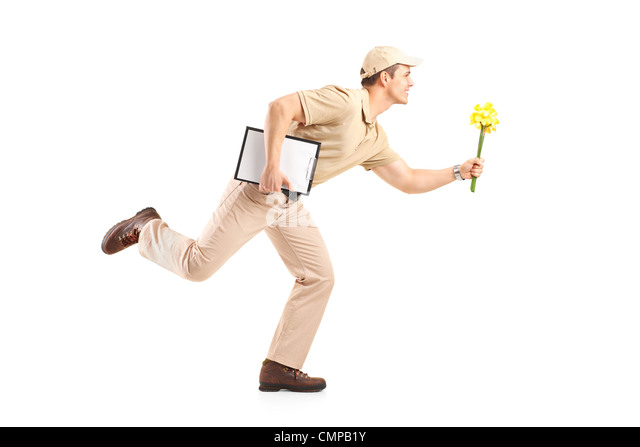 Delivery boy in a rush delivering flowers isolated on white background - Stock Image