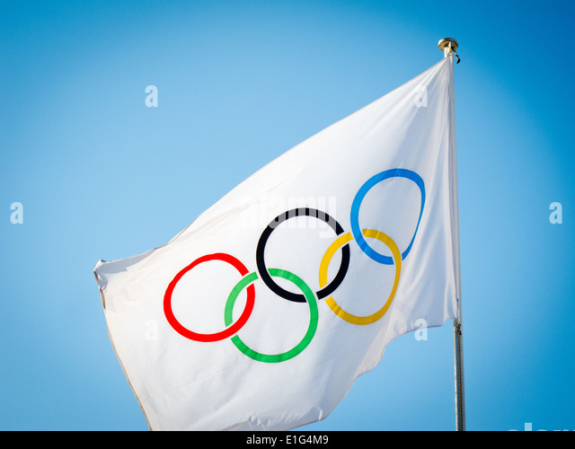 Olympics rings flag flying above the Olympic Panathenaic Stadium, Athens, Greece - Stock Image