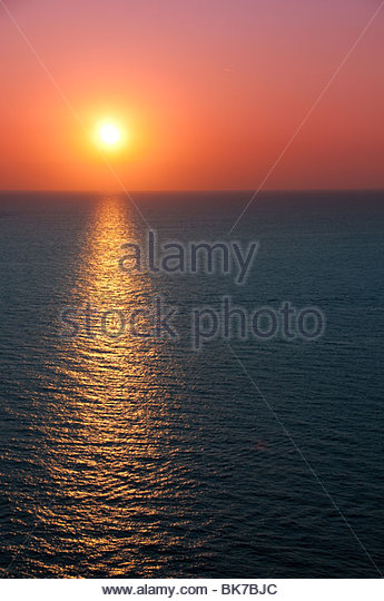 Sunset colors over the ocean sea sunrise - Stock Image