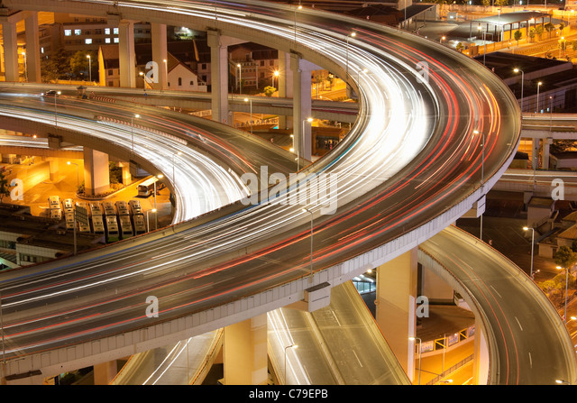 Traffic on Nanpu bridge roundabout at dusk; Dongjiadu: Shanghai; China - Stock Image