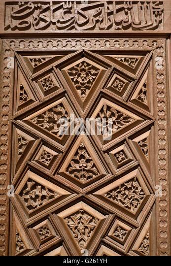 Carved wood door of a Mausoleum from 15th Century Mazanderan Iran - Stock Image