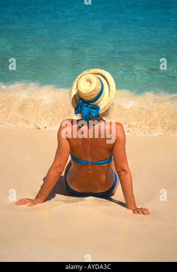 Woman Tropical Beach iconic vacation image colourtourist - Stock Image