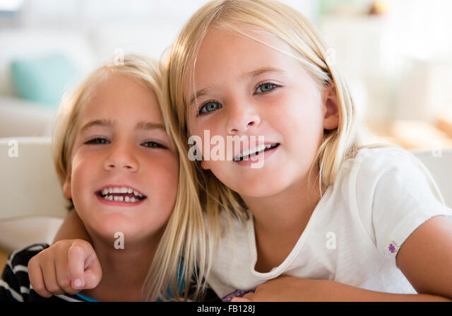 Portrait of brother (4-5) and sister (6-7) - Stock Image