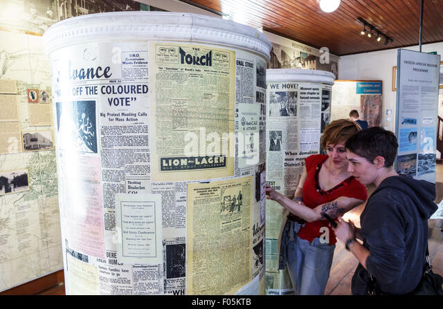 Cape Town South Africa African City Centre center District Six Museum apartheid inside exhibit exhibits woman friends - Stock Image