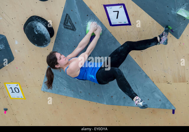 Montreal, Canada. 18th July, 2015. An athelete climbs a route during a outdoor climbing competition at Action Sport - Stock Image