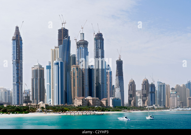 Skyline of modern high rise towers at Dubai Marina district United Arab Emirates UAE - Stock Image