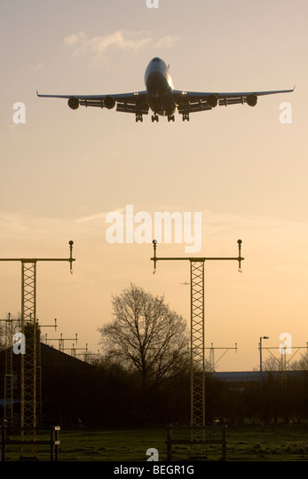 Large commercial airliner approaching London Heathrow Airport, England, UK. - Stock Image
