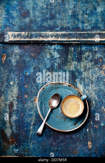 Espresso cup on blue background - Stock Image