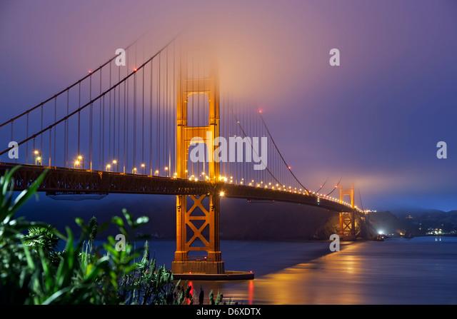 Golden Gate Bridge under fog, San Francisco, California USA - Stock Image