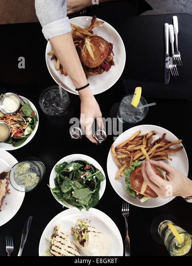Friends dining away - Stock-Bilder