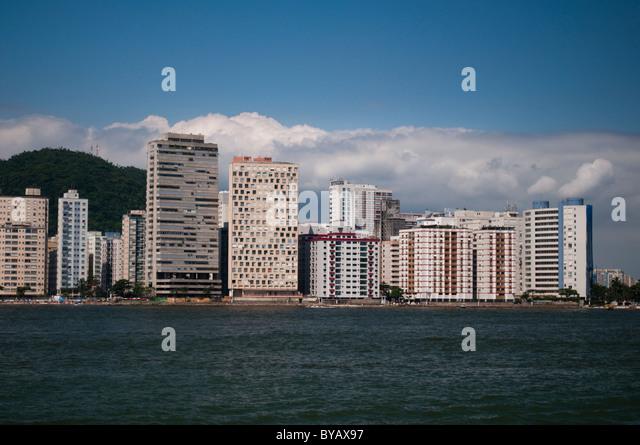 Shore line view of buildings of São Vicente, city in coast of São Paulo state, Brazil - Stock Image