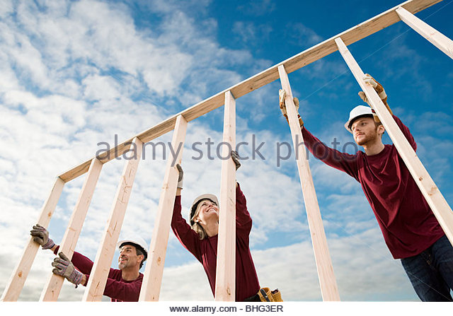 People with wooden construction frame - Stock-Bilder