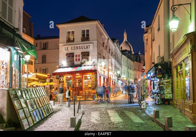 Le Consulat Montmartre at Night Paris France - Stock Image