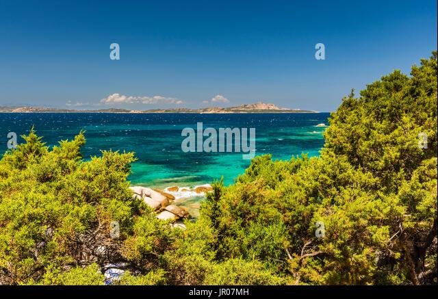 Wonderful azure seas and rocks around Baya Sardinia, Italy - Stock Image