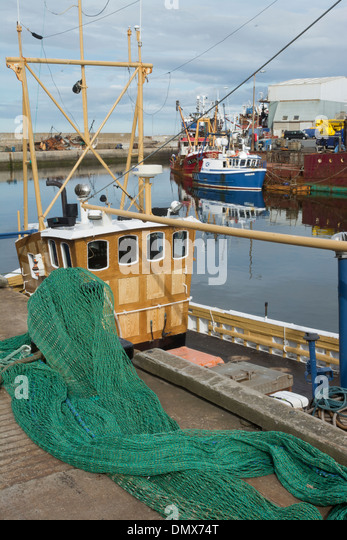 commercial fishermen boats nets harbour macdu - Stock Image