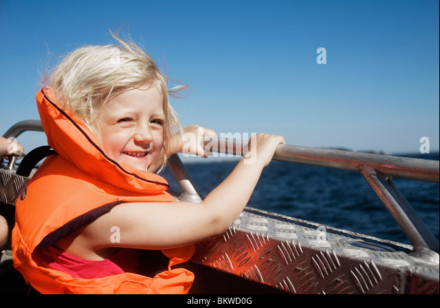 Blond girl in life jacket - Stock Image
