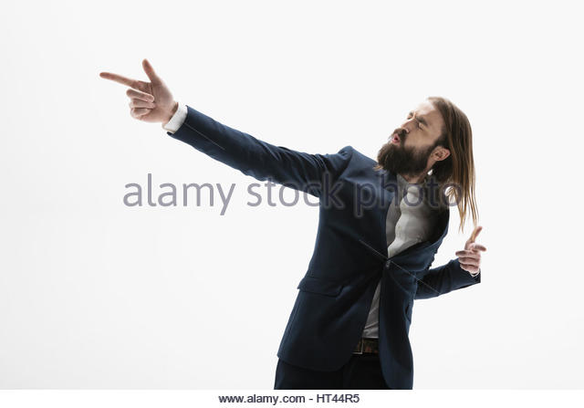Cool businessman with beard dancing and gesturing against white background - Stock-Bilder